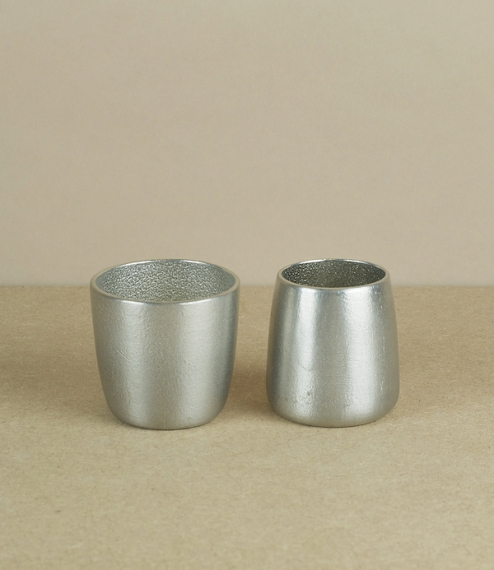 A pair of raw cast pure tin (≈99.8%) sake cups, generous shot or small wine glasses, or small tumblers; hand poured, chased, and finished by Nousaku, ..