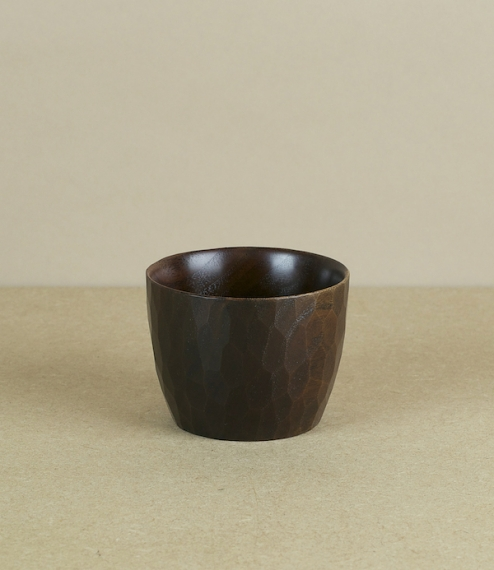 Fuki-urushi lacquered cups hand cut and finished by Seto Susumu from dark walnut or reddish sakura (Japanese cherry) in his small workshop in Asahikaw..