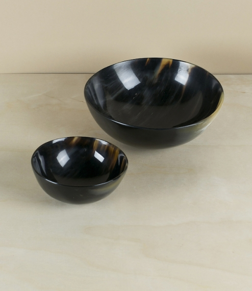 Natural horn bowls in two sizes, small approximately 100mm in diameter, or large at about 160mm. Ranging from white, to translucent amber, through all..