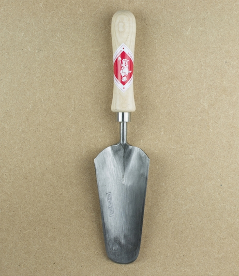 An ash handled long flowerbed trowel, with a narrow blade for planting or transplanting young plants whilst minimising damage to surrounding specimens..