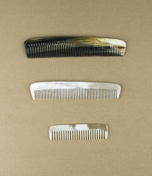 Natural ox-horn combs in three sizes, a small (about 88mm) single broad toothed comb for pockets, wallets, handbags, purses, or travelling, a medium s..