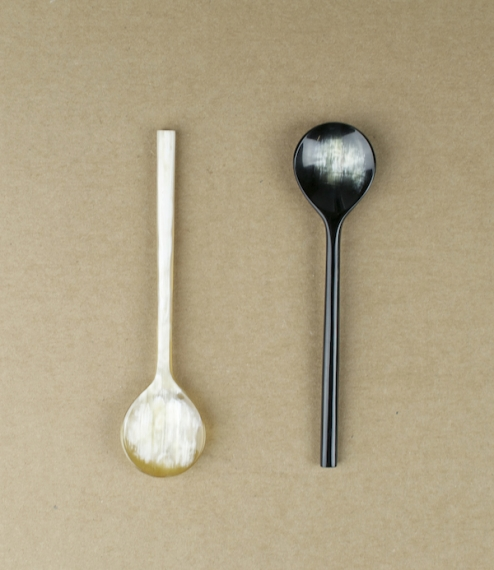 A round headed spoon with a longish fine handle, of a type traditionally used for the serving or yoghurt, pickles, or preserves, as it neither tarnish..