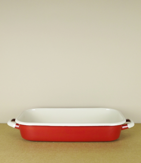 A red and cream enamel roasting pan. Made in Olkusz, Poland, at a factory founded in 1907 by the Viennese industrialist Peter Westen and flourishing t..