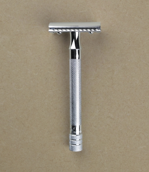 A long handled chrome plated straight cut closed comb safety razor from Merkur of Solingen. Since the 1900s Emil Hermes which eventually took the name..