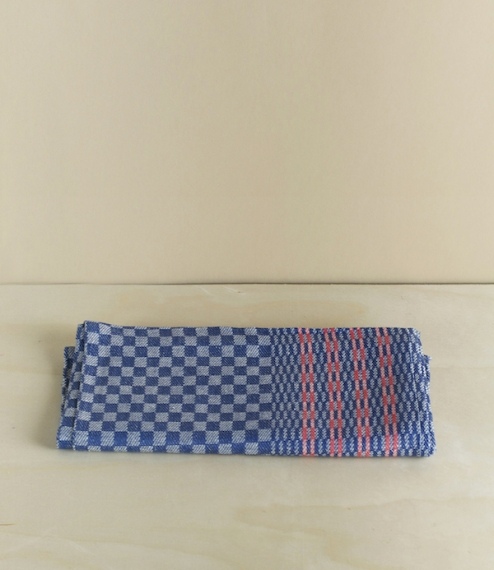 Indigo and white checked jacquard woven 50% linen/cotton union blend kitchen towels with red banding to the long edge and hanging loops to either end...