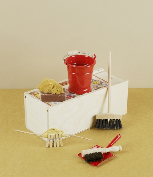 A miniature or doll's sweeping and cleaning set contained in a neat wooden case. Includes a naturally bristled floor broom, red lacquered bucket, pegs..