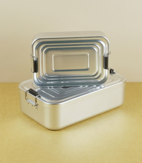 Simple but well engineered pressed aluminium lunch-boxes from Solingen in Germany, with satisfyingly tight fitting rattle free lids held in place with..