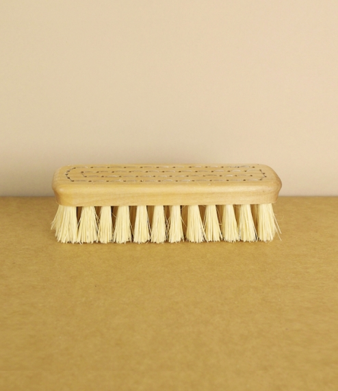 A nailbrush of oiled boreal birch and golden tampico fibre hand-stitched by the crafts people of a Finnish visually impaired workers cooperative. Tamp..