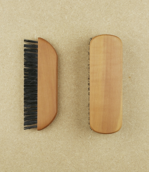 Clothes brushes of waxed pear-wood and strong black natural hog bristle in a standard or pocket format. The pocket brush has two rows of bristle being..