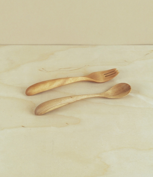 Small chlidren's forks and spoons hand cut, ground, and finished by Inoue Hiroyuki of Atelier akarino-tane in Asahikawa City, of birch cut from the fo..