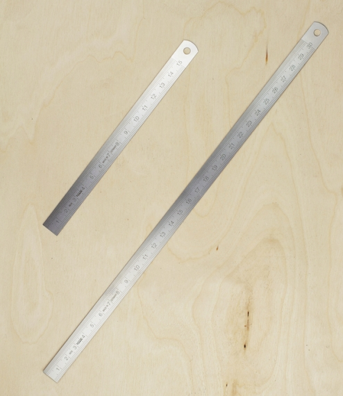 Moderately flexible rulers of 0.5mm stainless steel, either 15cm or 30cm measuring length and 13mm wide. Zeroed to one end, with a hole for hanging at..