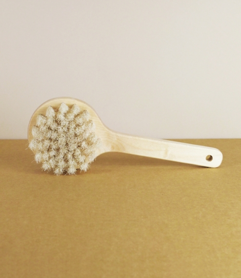 A body brush with an oiled birch stock cut from slow growing Fennoscandian boreal forests, and hand stitched with horse hair blend bristles by the cra..