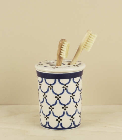 Blue and white stoneware lidded toothbrush holder and beaker. Handmade and decorated at a polish pottery and craft co-operative...