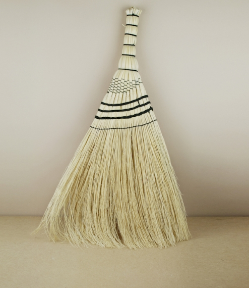 A medium sized black twine bound broom of broom-corn or rice-straw, which is neither from rice nor corn, but a kind of sorghum grass traditionally pla..