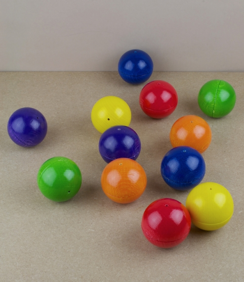 Musical balls sold either as a complete set of 12 - two each of red, green, yellow, orange, blue, and purple - in a cotton bag, or else individually (..