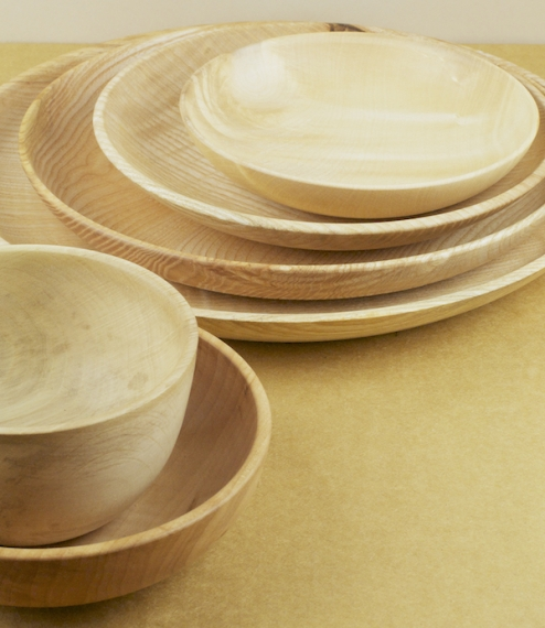 Hand turned deep rimmed plates and bowls of various sizes made indigenous hardwoods (mostly ash and sycamore) in the workshop of Alistair Phillips, am..
