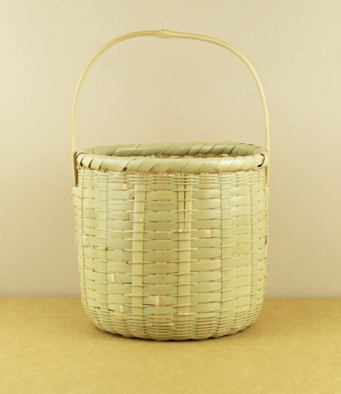 A beautifully hand-woven and deceptively sturdy water resistant split bamboo basket from Ehime Prefecture in southern Japan of a type traditionally us..