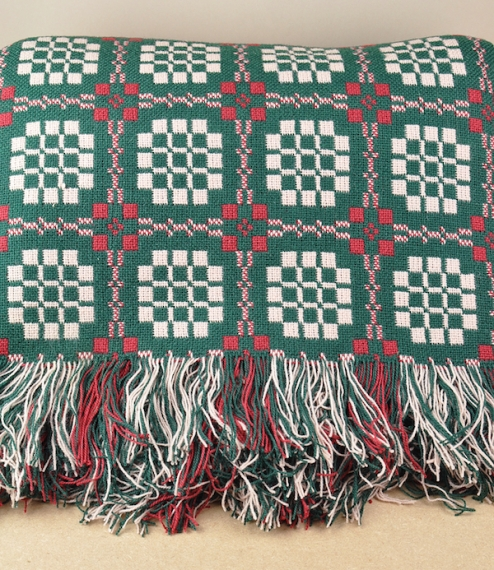 After a long hiatus they are finally back! Deep green, red, and camel Pennsylvania pattern Welsh tapestry blankets and throws, woven in Cynwyl Elfed, ..