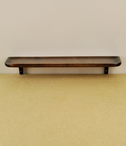 A small fuki-urushi lacquered sakura (Japanese cherry) shelf with a shaped, concave surface ideal for holding pens, pencils, or other small roll prone..