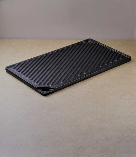 A pre-seasoned double burner cast iron reversible griddle, ridged to one side, flat on the other, ideal for meats, halloumi, and all manner of drop sc...