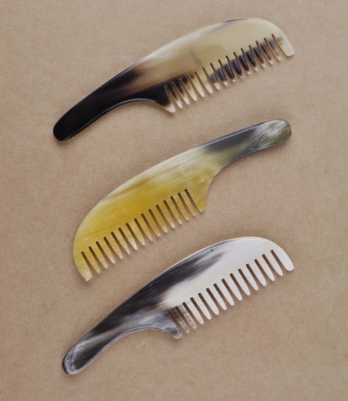 A small natural ox-horn comb for the tidying of beards and moustaches. Hand sawn, shaped, and polished in Carnforth, Lancashire, at the last remaining..
