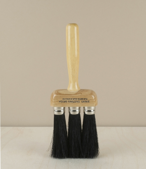 A black hog bristled dust brush set with 3 separately ferruled heads giving a less dense, therefore softer head whilst retaining the spring of stiffer..
