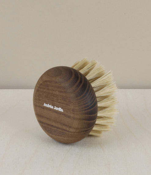 A small bathing or massage brush with white silk bristles set into a heat treated French ash stock. 'White silk' is type of soft pig bristle, a little..
