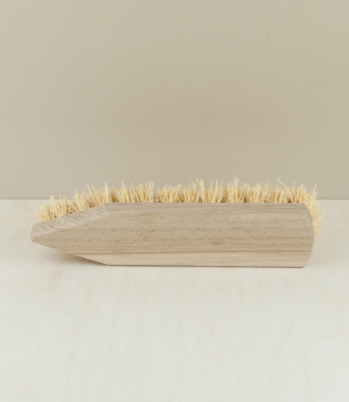 A flat scrubbing brush of waxed beech and a fibre known as rice root, which isn't from rice at all, but from zatacon, a grass native to the high arid ..