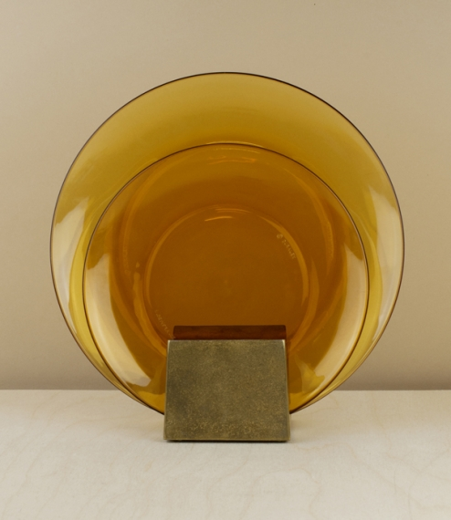 Simple, amber pressed-glass plates made in Duralex's La Chapelle-Saint-Mesmin plant using the renowned and patented Saint-Gobain tempering process. Go..
