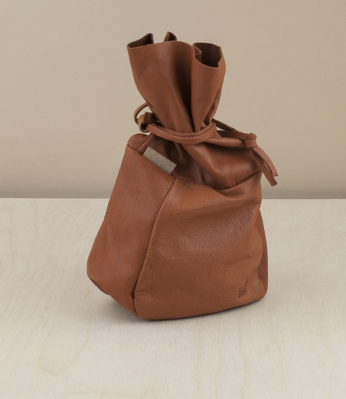 A naturally bark tanned reindeer leather storage bag from Swedish Lapland and of a type traditionally used by the nomadic Sami people for the storage ..