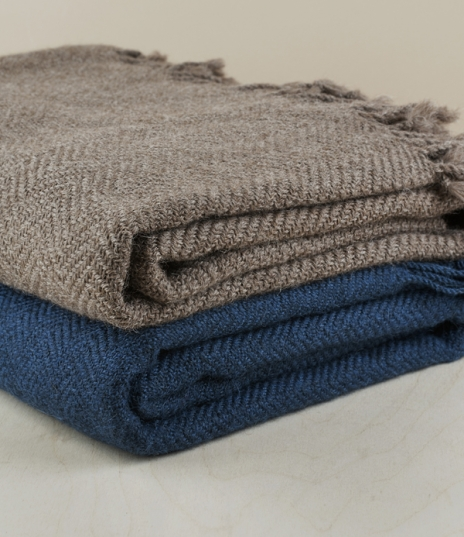 Hand-woven on a traditional Andean loom, these light, yet warm blankets are made using 100% locally sourced alpaca from herds that graze between 3,500...