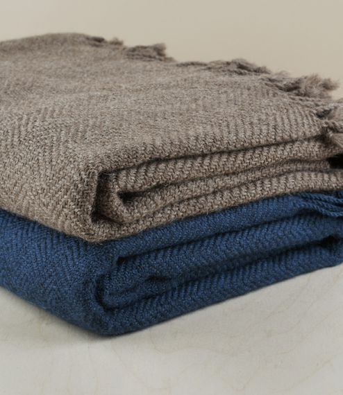 Hand-woven on a traditional Andean loom, these light, yet warm blankets are made using 100% locally sourced alpaca from herds that graze between 3,500..