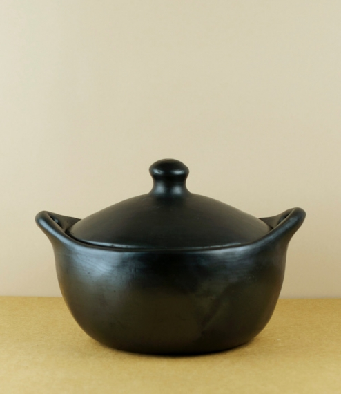 Hand formed black clay cookware from small village producers in Columbia. Using a method barely changed in 700 years the pots are first formed of a ro..
