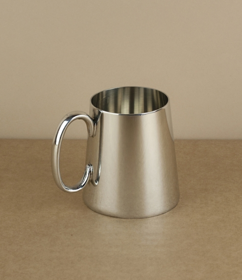 An Imperial quarter pint heavyweight tankard with a plain polished finish and simple C shaped handle following a simple unadorned design used in Victo..