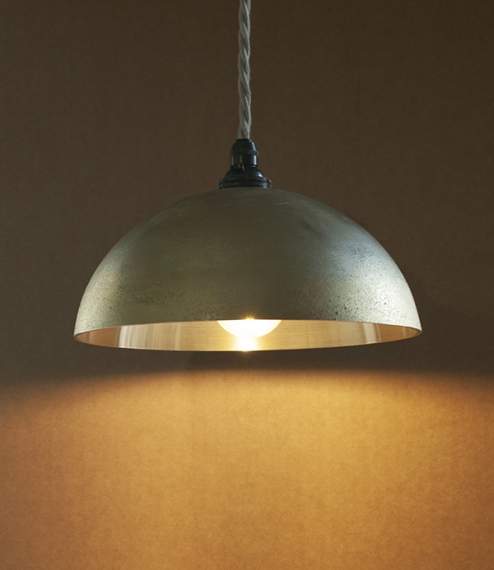 A range of i-hada and kuro-mura sand-cast brass pendent lamps from Japan. The i-hada castings are left 'in their skin', meaning their raw cast surface..