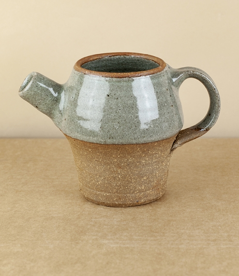 A spouted jug fired in a 'blue grey' glaze. After training in Cardiff and Gothenburg, Sweden, Welbourne set up studio in Cardiff, where he produces wh..