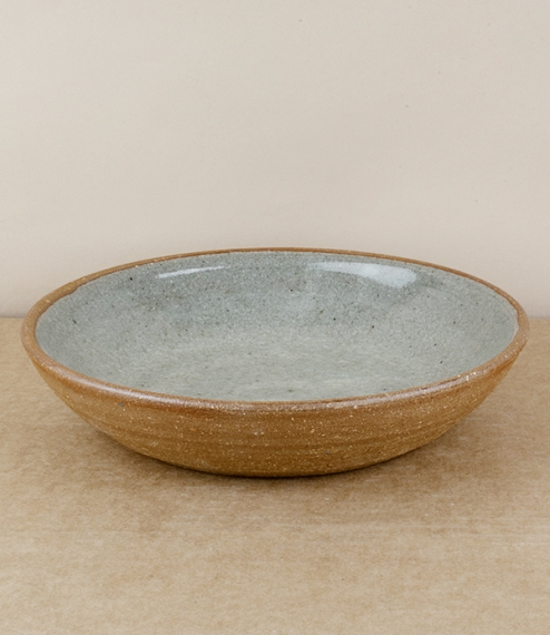 An internally 'blue-grey' glazed mid sized serving bowl. After training in Cardiff and Gothenburg, Sweden, Welbourne set up studio in Cardiff, where h..