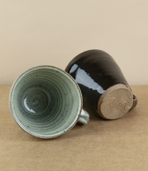 A choice of generously proportioned flared mugs in black tenmoku or blue-grey nuka glazes. After training in Cardiff and Gothenburg, Sweden, Welbourne..