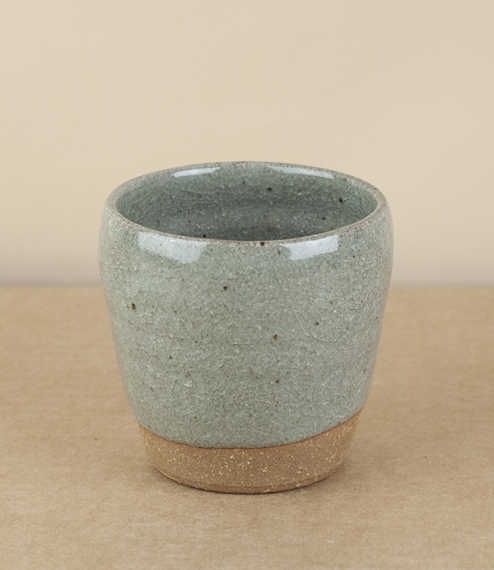 A simple tumbler fired in a 'blue grey' glaze. After training in Cardiff and Gothenburg, Sweden, Welbourne set up studio in Cardiff, where he produces..