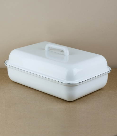 A good sized rectangular white vitreous enamel on press formed steel bread bin with a handled lid and holes allowing the bread to breathe. From the wo..