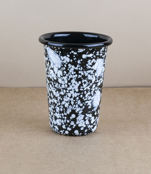 An approximately 9cm diameter, 13cm high, 500ml capacity pressed steel vitreous enamelled straight tapered side tumbler with white splatter over a bla..