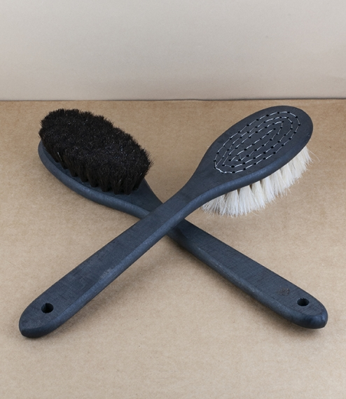 Longer handled body brushes made with boreal birch stocks soaked in pine tar as a protective and preservative, and hand stitched with either softer bl..