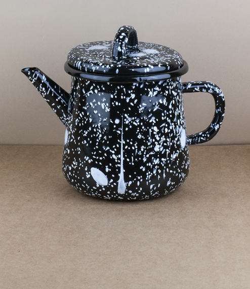 An approximately 13cm diameter, 1.0l capacity pressed steel vitreous enamelled teapot with white splatter over a black enamel base. Bornn Enamel is a ..