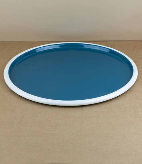 An approximately 28cm diameter pressed steel vitreous enamelled low lipped serving, baking, or pizza tray with an ocean blue interior over a white ena..