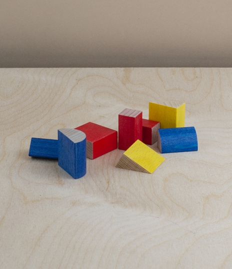 A toy of simple Bauhaus inspired geometric shapes and primary colours created in 2011 to celebrate the 20th anniversary of the founding of SINA Speilz...