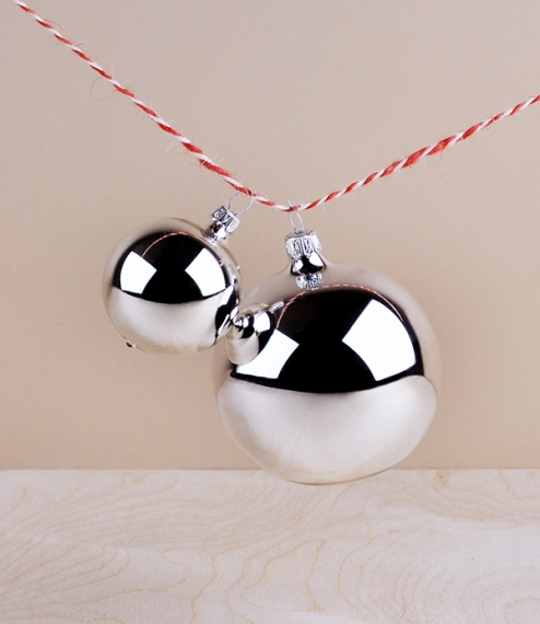 Traditionally silvered glass baubles for hanging upon fir trees at Christmas time. Reminiscent of petrified bubbles, and capturing no small share of t..