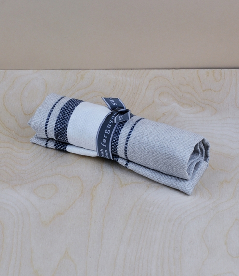 100% Irish linen kitchen towels in a naturally thicker and more textured huckaback weave, naturally coloured with blue/off-white stripes. Manufactured..