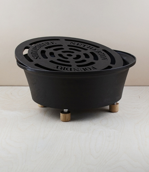 A compact spun-iron garden hob, with British oak feet, suitable for use on decking or patio. This compact garden hob will stay hot for hours, and won'..