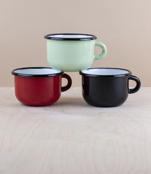 A choice of 0.25 litre 8cm diameter 5.5cm high black rimmed and various coloured vitreous ceramic enamel low mugs from Ukraine. Firing in a traditiona..