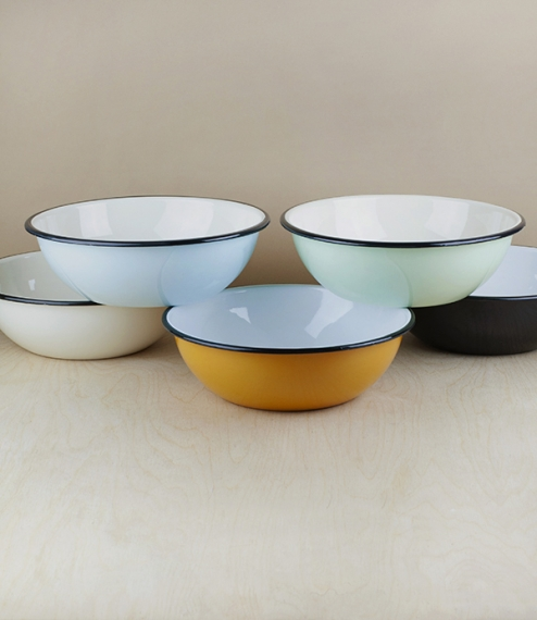 A choice of various coloured 24cm diameter black rimmed vitreous ceramic enamel serving, prep, or cooking bowls. Firing in a traditional kiln results ..